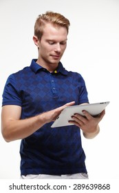 young blond man in with a tablet in hands