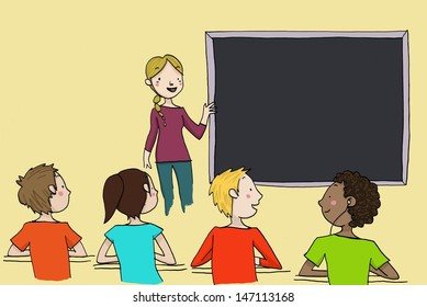 Young blond teacher explains at the blackboard to a classroom