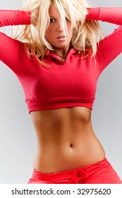 young blond tight body woman in sport wear, studio shot