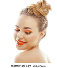 young blond woman with bright make up smiling pointing gesturing emotional isolated on white like doll lashes