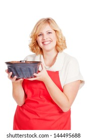 young blond woman with bundt cake and red apron
