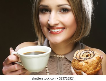 young blond woman with coffee and cookies.