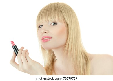 Young blond woman doing makeup with lipstick