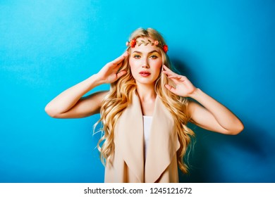 young blond woman dressed like ancient greek godess, jewelry clo