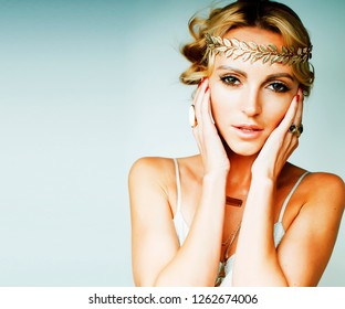 young blond woman dressed like ancient greek godess