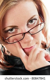 Young blond woman with finger at the eye.