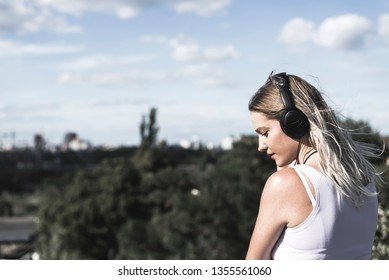 young blond woman with headphones