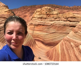 Young Blond Woman Hiking at The Wave in Arizona