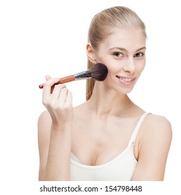 young blond woman holding cosmetics brush on white