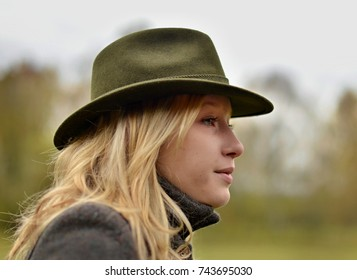 young blond woman in hunting hat