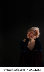 young blond woman on black background - studio shot - nostalgic ambiancefree space for text