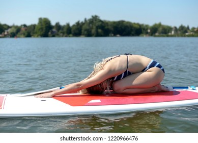young blond woman on paddleboard