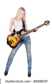 Young blond woman playing on the electric bass guitar, isolated on the white background.