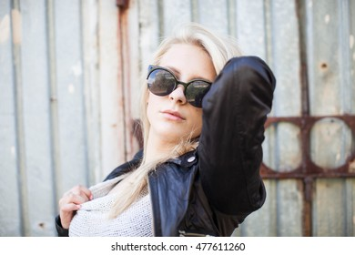 young blond woman with sunglases