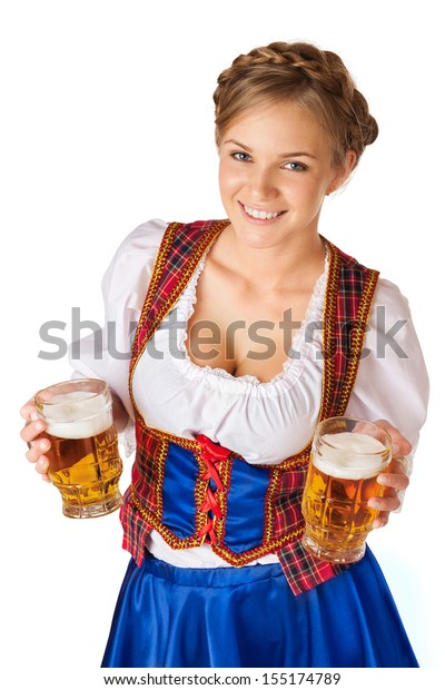 Young blond woman with two mugs of beer, dressed in national costume of Germany