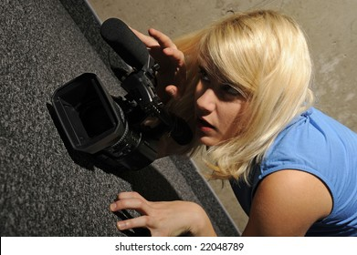 young blond woman with video camera