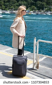 Young blond woman waiting for the ferry