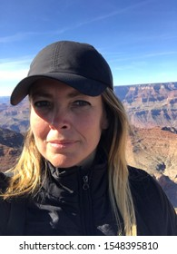 Young Blond Woman wearing a hat at Grand Canyon