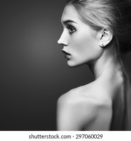 Young blond woman.Beautiful blonde Girl.close-up fashion monochrome portrait