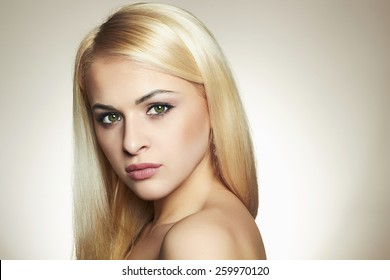 Young blond woman.Beautiful Girl with green eyes.Fashion portrait