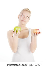 Young blonde with apple isolated on white. Focus on red apple.