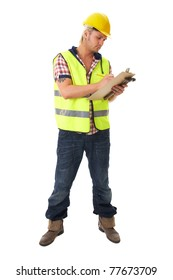 young blonde attractive builder, worker, wears yellow hardhat and hi-vis vest, takes some notes on his small board, isolated on white