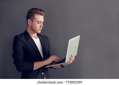 Young blonde business man isolated studio concept