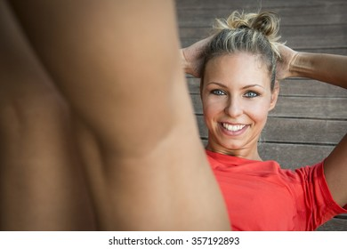 young blonde caucasian woman is happily doing exercises