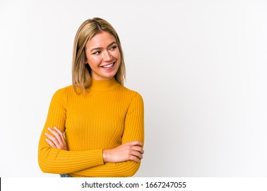 Young blonde caucasian woman isolated smiling confident with crossed arms.