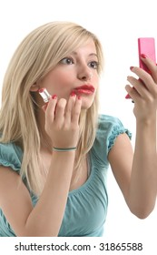 A young blonde doing make up with her small mirror.