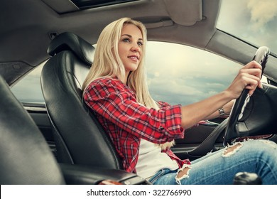 Young blonde drive a car