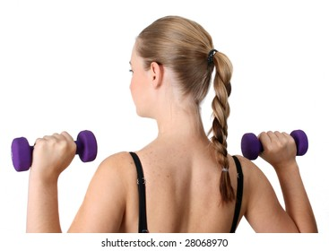 Young blonde exercising with light purple weights