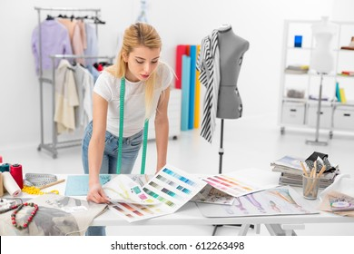 young blonde fashion designer woman checking color palette samples