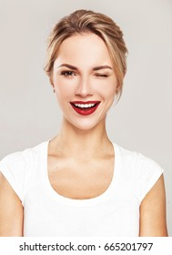 Young blonde fashion model, with bright smile
