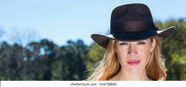 Young Blonde Female In Black Hat