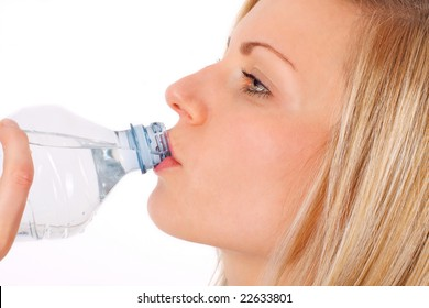 young blonde female drinking water from a bottle