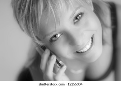A young blonde girl with a cellphone