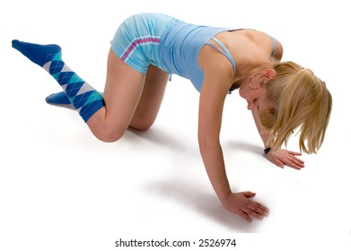 Young blonde girl doing morning aerobic exercise