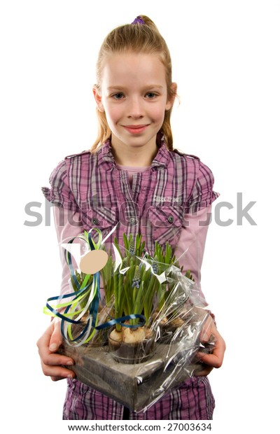 Young blonde girl gives Muscari botryoides flowers isolated on white background