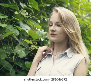 young blonde girl in the park portrait toning