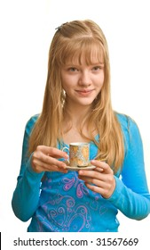 Young blonde lady and a cup of tea in her hand