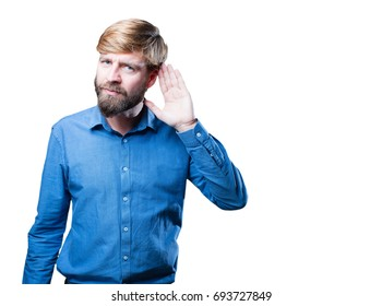 young blonde man listening. surprised expression