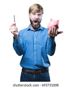 young blonde man with a piggy bank