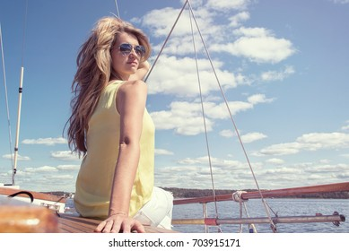 Young blonde on the deck of a ship at sea