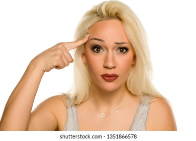 Young blonde with questionable gesture on white background