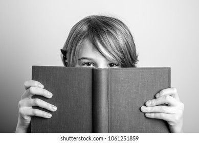 young blonde smiling guy with book - black and white photo