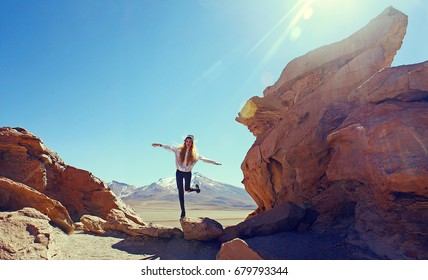 young blonde woman among Rocks Valley, Bolivia
