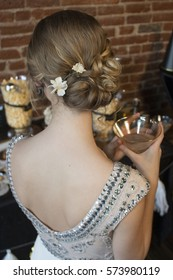 Young Blonde Woman with Beautiful Flowered Updo