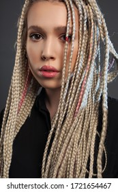 Young blonde woman with dreadlocks