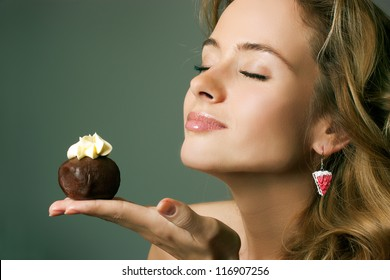 Young Blonde Woman Eating the Cake